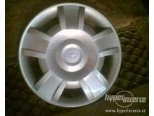 Fotka k inzerátu Chevrolet- prodám jednu originál poklici,14palcu, pěkná, bez poškození, / 11419742